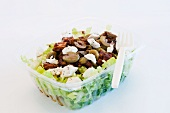 Salad To-Go in a Plastic Container with a Platic Fork; White Background