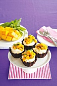 Chocolate baskets filled with mango and mint cream topped with mango salsa