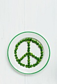 A peace sign made out of peas