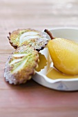 A poached pear in lemon grass syrup and financier cakes with pears and pistachios