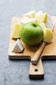 A green apple, chunks of celeriac and chunks of potato
