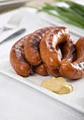 Grilled sausages with mustard