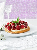 Raspberry tartlet with vanilla cream