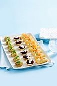 Colourful, savoury finger food; open sandwiches, tarts and mini pancakes