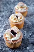 Butterfly cupcakes with blackcurrant jam