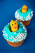 Cupcakes topped with decorative ducks
