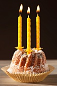 A Bundt cake with lit candles, for a birthday