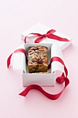 A miniature fruit cake as a Christmas present