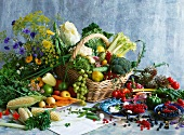 Assorted vegetables, grapes, berries, herbs and flowers