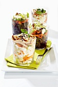 Assorted vegetable salads in glasses