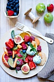 A large fruit salad with mint ice cream
