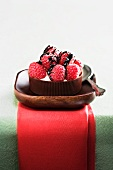 Raspberries with Chocolate Drizzle on Mascarpone Cheese in a Chocolate Cup; Spoon