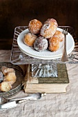 Doughnuts on a cake stand on top of an old book