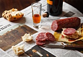 Hard Salami with Bread and a Glass of Sherry on Polish Newspaper