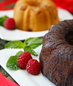 Two Bundt Cakes; Chocolate and Almond; Fresh Raspberry Garnish