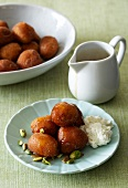 Honey doughnuts with pistachios and ricotta