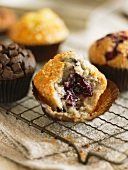 A blueberry muffin with a bite missing