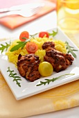 Chicken with saffron rice and cherry tomatoes