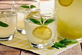 Homemade Country Lemonade garnished with some mint leaves, selective focus