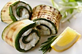 Grilled zucchini rolled up with ricotta - herb paste