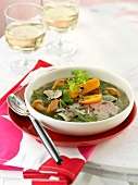 Beef soup with chanterelle mushrooms and slices of truffle