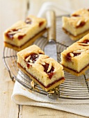 Raspberry and almond slices on a cooling rack