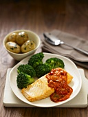 Salmon fillet with tomato sauce, broccoli and parsley potatoes