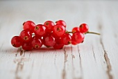 Redcurrants on a weathered wooden surface