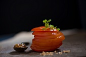 Sliced tomato with mustard, curing salt and Greek basil