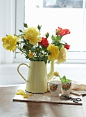 Bouquet of roses in jug in front of window