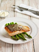 A salmon fillet on green asparagus