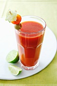 A glass of tomato juice with a vegetable skewer