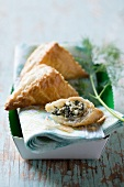 Puff pastry parcels filled with spinach and feta