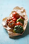 Assorted heirloom tomatoes on crumpled paper