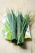 Two bunches of chives on a cloth