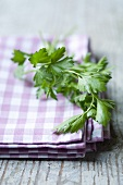 Flat-leaf parsley on a checked cloth