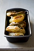 Oven-baked potatoes with bay leaves