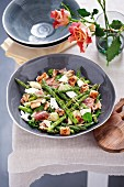 Grilled asparagus salad with Chevin cheese, ham and croutons