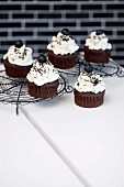 Black cupcakes topped with white cream