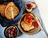 Bread with Jam, A Bowl of Fresh Berries and a Basket of Sliced Bread