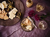 Assorted Cheese, Crackers, Gherkin Pickles and Glasses of White Wine