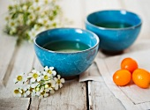 Two Asian Style Tea Cups with Kumquats