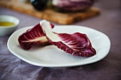 Two Radicchio Leaves on a White Plate