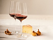 Two Glasses of Red Wine with Cheese and Figs