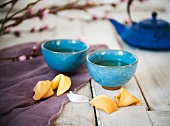 Two Cups of Tea in Asian Style Tea Cups with Fortune Cookies