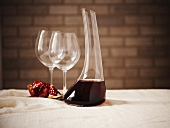 Red Wine in a Wine Decanter with Two Empty Glass and Pomegranate