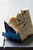 A wedge of Bleu d'Auvergne cheese