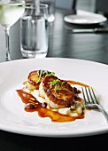 Fried scallops with cauliflower puree and a pomegranate and lime dressing