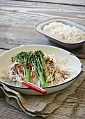 Rice noodles with fish and broccoli