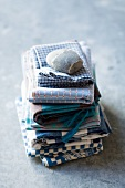 Assorted tea towels, stacked